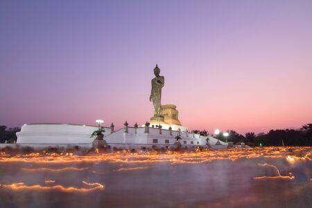 rite: light waving rite around the big buddha statue with long time of shutter speed Stock Photo