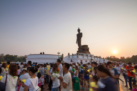 rite: Nakhon Pathom, Thailand - February 22, 2016 : light waving rite around the big buddha statue ,Nakhon Pathom, Thailand