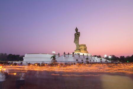 rite: Phutthamonthon,NakhonPathom,Thailand - February 22, 2016  : light waving rite around the big buddha statue with long time of shutter speed