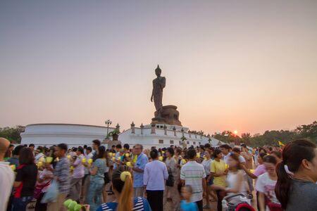 rite: Phutthamonthon,NakhonPathom,Thailand - February 22, 2016  : light waving rite around the big buddha statue Editorial