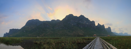 big behind: Panorama of Big mountain with sunrise beam behind