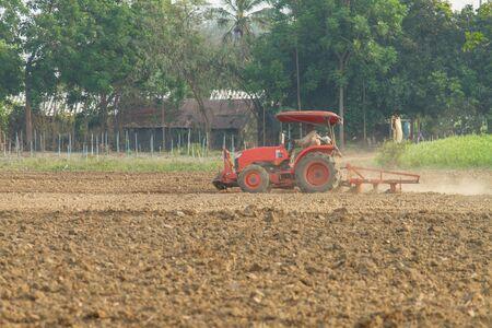 plough land: tractors plow the farm Stock Photo