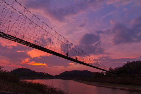 sunligh: silhouette of rope bridge in the sunset time