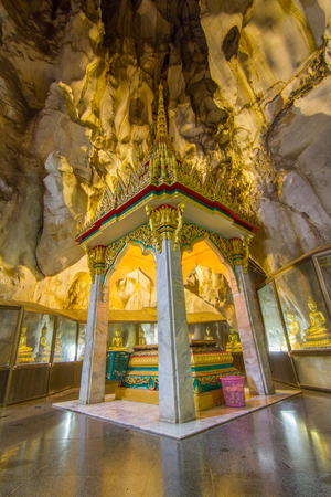 relics: KhaoYoi,Phetchaburi,Thailand - April 10,2016 : Buddhas relics in the cave of Thai temple Editorial