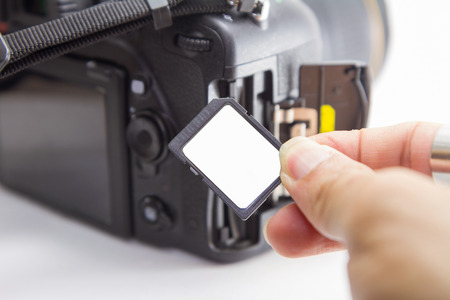 sd: insert sd card to camera Stock Photo