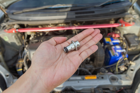 Oil regulator valve of the car in the hand