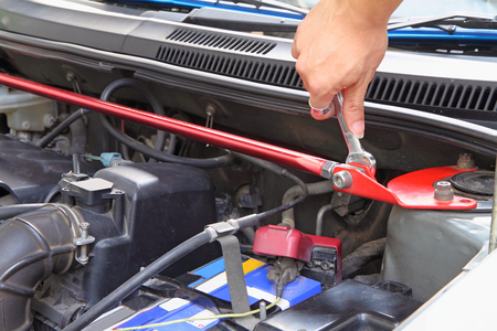 replacing: Turn the wrench for replacing front strut bar