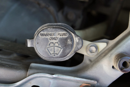 fluid: Washer fluid tank of old car