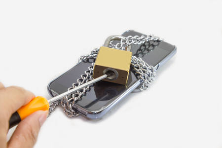 Hacking the securiy of mobile phone concept  Destroy the Lock mobile phone Stock Photo