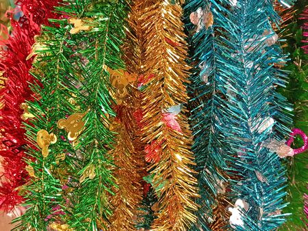 Shiny rainbow colored christmas foil tinsel garland happy new