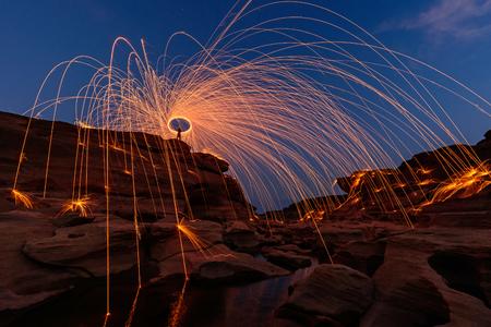 Swirl lights by steel wool   jerk the steel wool light at Sam Phan Bok Stock Photo