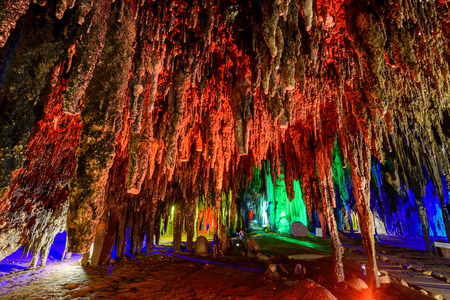 Stalactite stalactites with color lighting in cave Stock Photo