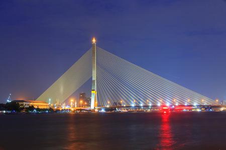 Big Suspension bridge with lighting in night time  Rama 8 bridge in night time