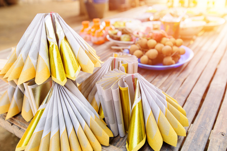 silver and gold paper / joss paper in make offerings to the spirits in Chinese new year festival