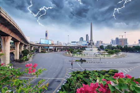 thunderclap with black cloud at victory monument landmark in Bangkok Editorial