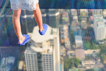 Traveler walking on the glass floor of high building 写真素材 - 120638891