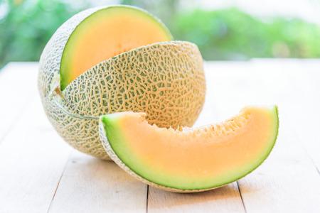 split the orange melon on wood plate Reklamní fotografie