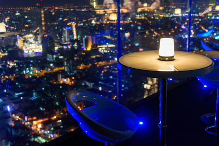 empty chair with lighting at rooftop bar on high building