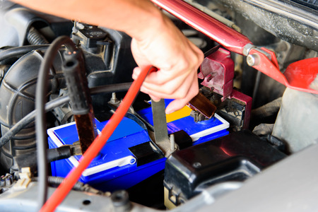 jumping the car battery / charging car battery Stock Photo - 122964547