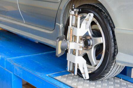 Car Wheel Alignment in tire garage service 版權商用圖片
