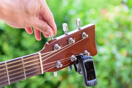 guitar tuners tool  tuning guitar strings notes Stock Photo