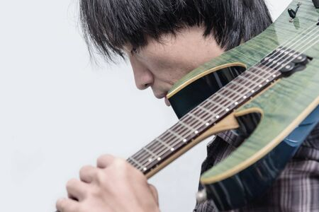 The man shoulder the electric guitar Stock Photo