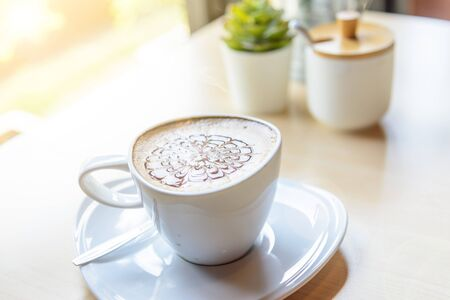 hot coffee on table / hot cappuccino with nice pattern milk foam Archivio Fotografico - 138047000