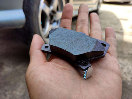 close up to brake pad of the car in hand