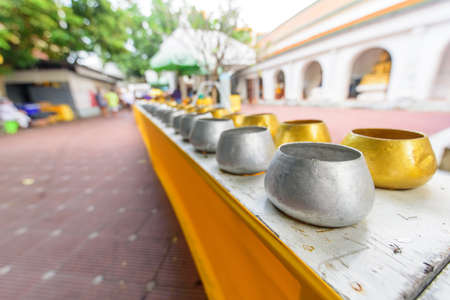Nakhonpathom, Thailand - 31 October, 2020: gold and silver Monk's bowl  in Praying Homang to Phrapathom Chedi event