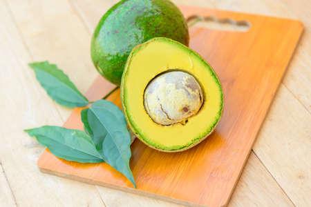 Fresh avocado split on the wood plate Zdjęcie Seryjne
