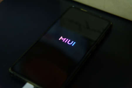 Rachaburi,Thailand - 21 February, 2021: Closeup focus to Smartphone model Mi9T updating MIUI android version 12 and Logo in reboot step