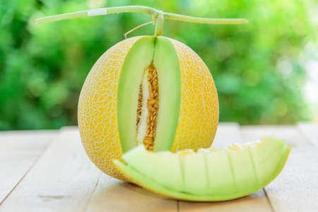 Closeup to Fresh yellow galia melon in dish on wood plate