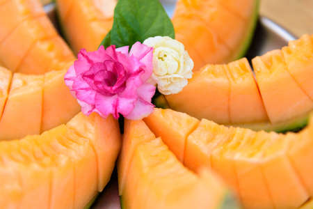 piece of fresh orange melon on the plate 版權商用圖片