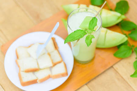 Milk melon Smoothie in glass with Roast bread