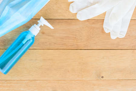 sanitizer gel for cleaning the hand and Medical rubber gloves on background