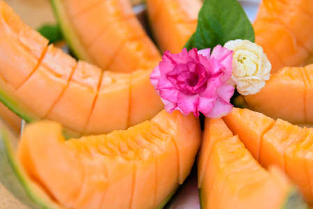 a lot of piece of fresh orange melon on the plate