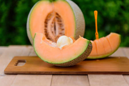 Closeup to ice cream melon on wood table