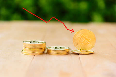 Bitcoin stocks fall. Red arrow show Bitcoin falling down