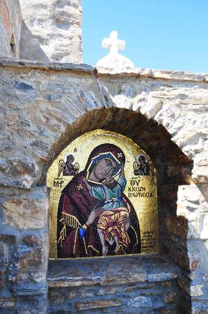 Amorgos island, Greece, August 16, 2012 - Maria painting on glass at Byzantine Monastery