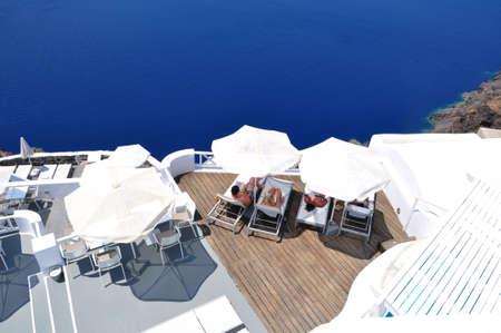 Relaxing at balcony, Santorini island Stock Photo