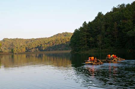 Pang oung lake, maehongson provinces, Thailand - November 1, 2012 - tourist  enjoy bamboo Float rafting in Pang oung lake