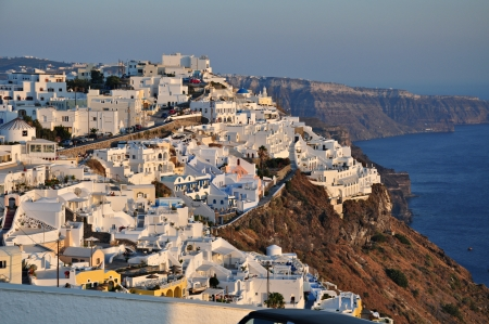 the Capital of Santorini Island Fira town, perched high on the cliff top above the edge of the ancient volcano Stock Photo