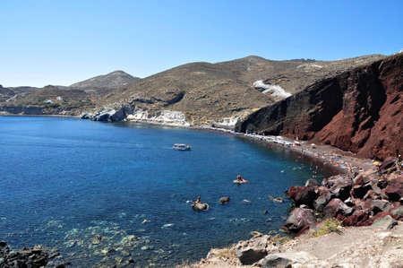A small traditional boat take tourists to Kokkini Akti,  Red Beach  and Aspti Akti  White Beach