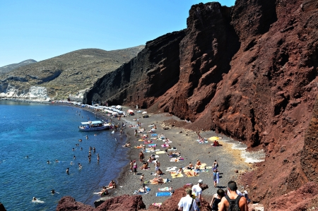 Red Beach in Akrotiri, santorini island, Greece. Photo taken at 10th of August 2012 A small traditional boat transported tourists to Kokkini Akti, (Red Beach) and Aspti Akti (White Beach)