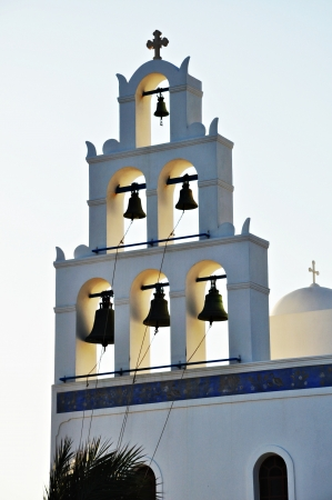 Greek church bell tower in Oia village, Santorini, Greece