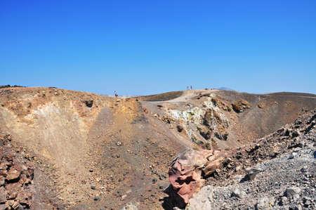 Tourists walking on the volcano ridge