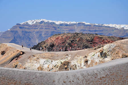 climbing up the volcano under the hot greek