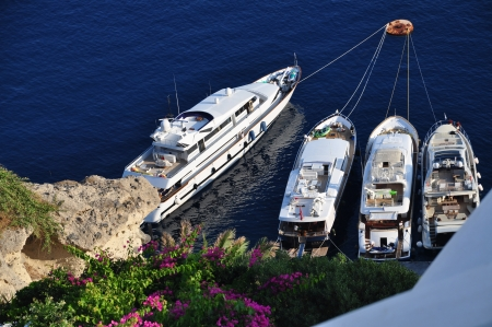 Oia village, Santorini island, Greece, 12th August 2012 - boats mooring of the coast of Oia