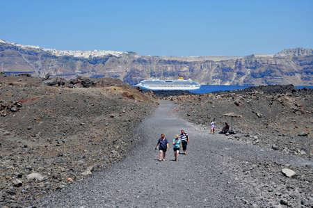 Santorini island, Greece, August 13, 2012 -Tourist excursion to the volcanic crater on the Santorini island, Greece  Editorial