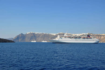 cruiser in deep blue Santorini volcano caldera photo